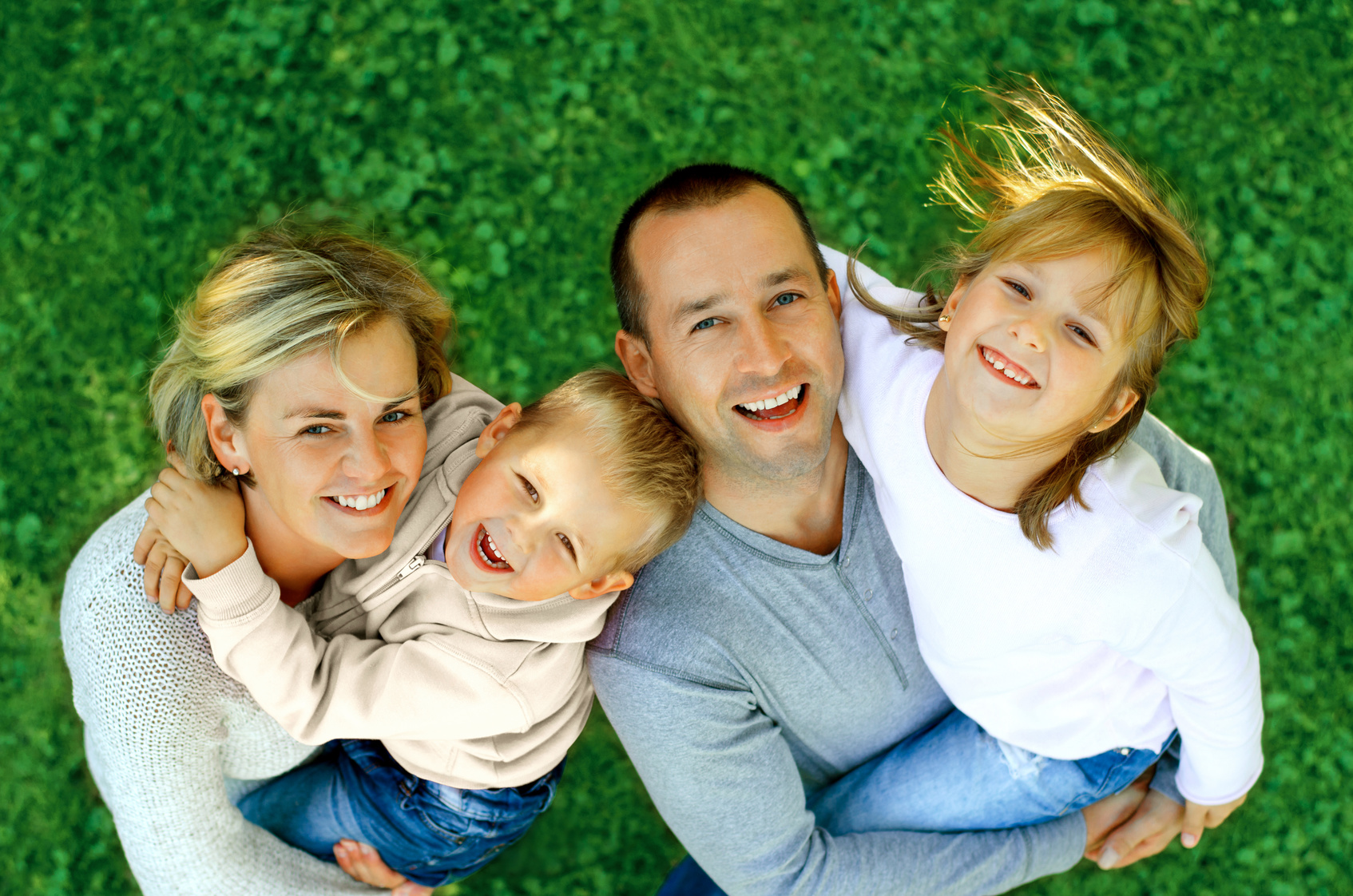 portrait of a happy family smiling a top view